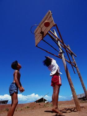 Children Playing Basketball at Honda Bay, Puerto Princesa, Philippines by Tom Cockrem