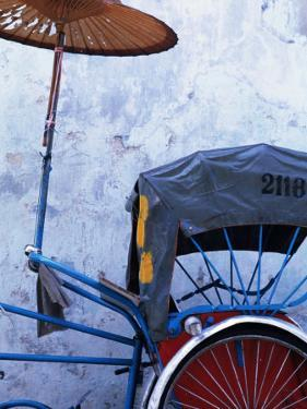 Detail of Rickshaw Leaning Against Wall on Cintra Street, Georgetown, Malaysia by Tom Cockrem