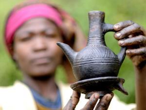 Dorze Woman with Black Coffee Pot by Tom Cockrem