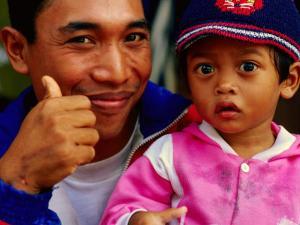 Father and Daughter at Pasar Badung, Denpasar, Indonesia by Tom Cockrem
