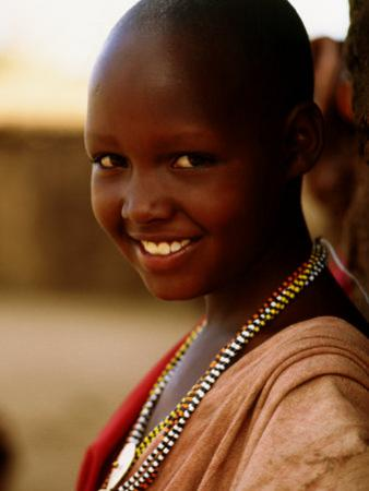 Maasai Girl, Masai Mara National Reserve, Kenya by Tom Cockrem