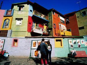Street Market and Colourful Buildings, La Boca, Buenos Aires, Argentina by Tom Cockrem