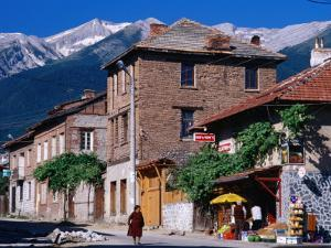 Village Buildings Beneath Pirin Mountains, Bansko, Bulgaria by Tom Cockrem