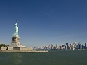 Statue of Liberty, Liberty Island and New York Skyline by Tom Grill