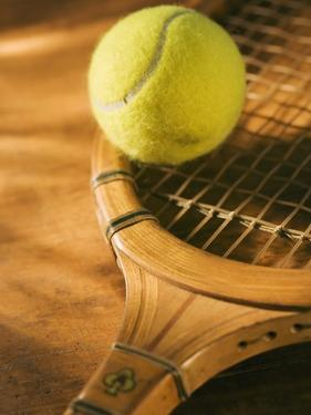Tennis Ball and Wood Racket by Tom Grill