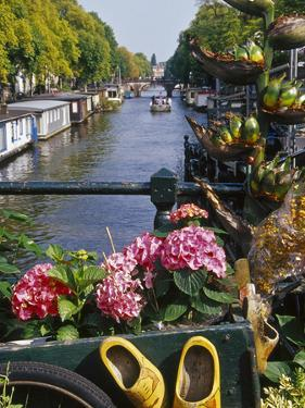 Flower Filled Cart with Houseboats and Canal, Amsterdam, North Holland, the Netherlands by Tom Haseltine