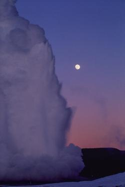 Old Faithful Erupts Beneath a Full Moon by Tom Murphy