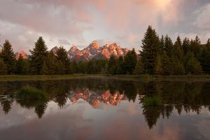 Reflections in the Snake River at Schwabachers Landing by Tom Murphy
