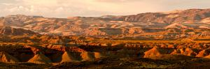 Sunlight Reflected Off Cliffs in the Wyoming Badlands by Tom Murphy