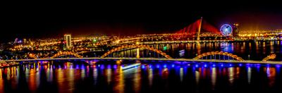 Colorful illumination of Dragon Bridge over Han River, Tet Festival, New Year celebration, Vietnam. by Tom Norring