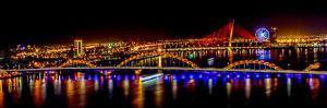 Colorful illumination of Dragon Bridge over Han River, Tet Festival, New Year celebration, Vietnam. by Tom Norring