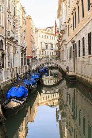 Gondola Parking under Bridge. Venice. Italy