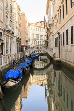 Gondola Parking under Bridge. Venice. Italy by Tom Norring