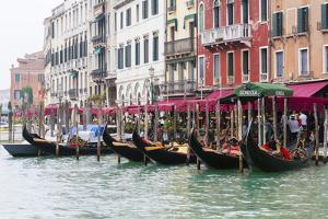 Gondolas and Restaurants at Grand Canal. Venice. Italy by Tom Norring