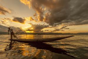 Intha Fisherman at Work. Using the Legs for Rowing. Inle Lake. Myanmar by Tom Norring