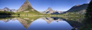 Mountains reflected in lake. Glacier National Park. Montana. Usa. by Tom Norring