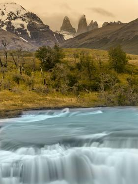 River and Waterfall with Las Torres. Torres Del Paine NP. Chile by Tom Norring