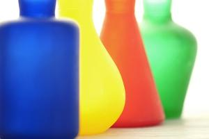 Coloured Bottles in a Row by Tom Quartermaine