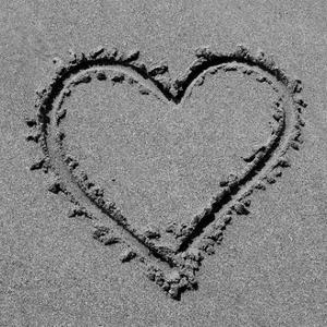 Heart drawn in sand BW by Tom Quartermaine