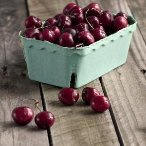 Red Cherries on Wood by Tom Quartermaine