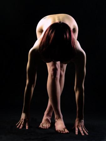 Back Lit Nude Woman Bending Down by Tomas del Amo