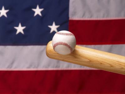 Bat Hitting Baseball Against Flag by Tomas del Amo