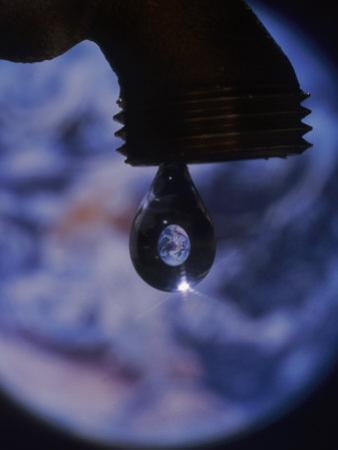 Image of Earth in Drop of Water by Tomas del Amo