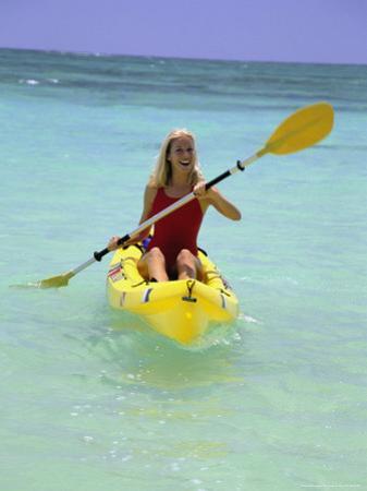Woman Kayaking at Beach, HI by Tomas del Amo