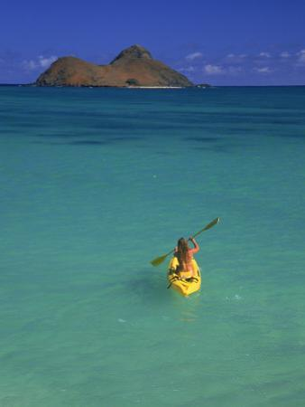 Woman Kayaking, HI by Tomas del Amo