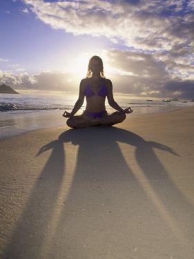 Woman Meditating on Beach by Tomas del Amo