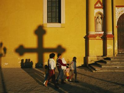 A Family Comes to Worship at the San Cristobal Church
