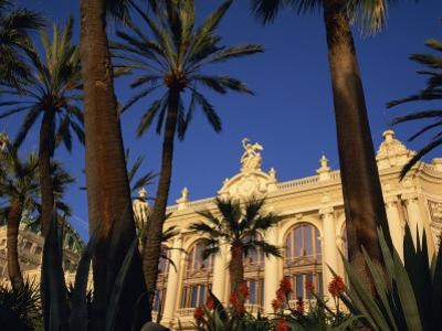 Casino Framed by Flowers and Palm Trees in Monte Carlo, Monaco, Europe