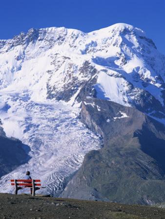 Hiker on Bench, the Breithorn and Breithorn Glacier, Rotenboden, Zermatt, Valais, Switzerland
