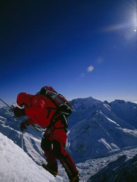A Climber Ascends a Steep Section of Ice on Nanga Parbat's Slopes by Tommy Heinrich