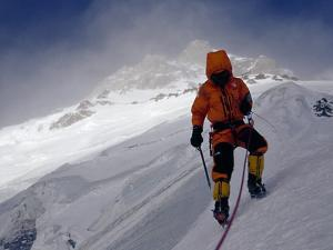 A Climber Ascends a Steep Slope of Nanga Parbat in Stormy Conditions by Tommy Heinrich