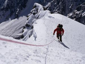 A Climber Ascends a Steep Slope of Nanga Parbat by Tommy Heinrich