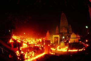 Bodghaya Mahabody Temple Illuminated by Candles by Tommy Heinrich