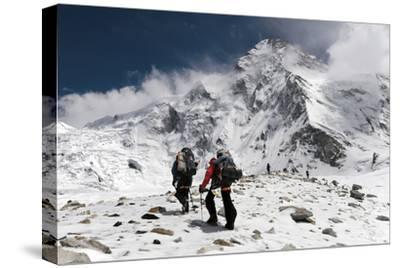 Expedition Members Climb a Ridge on the Chinese Side of K2