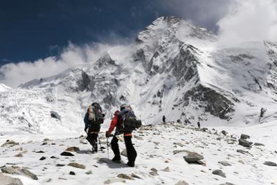 Expedition Members Climb a Ridge on the Chinese Side of K2 by Tommy Heinrich