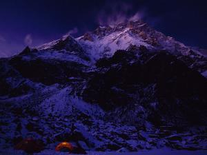 Nanga Parbat looms above the expedition's base camp by Tommy Heinrich