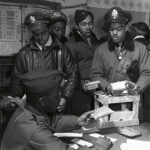 """""""Escape Kits"""" (Cyanide) Being Distributed to Black Fighter Pilots at Air Base in Italy, 1945 by Toni Frissell"""