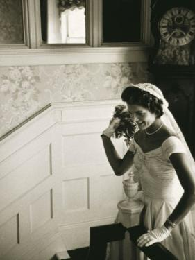 Jackie Kennedy Throwing the Bouquet by Toni Frissell