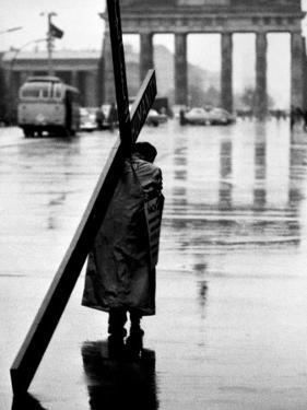 Man Carrying Cross, Berlin, October 1961 by Toni Frissell