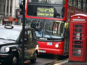 London Buses and Taxis in Heavy Traffic by Tony Burns