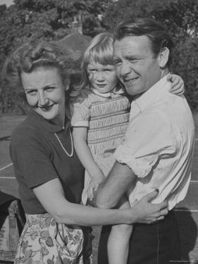 Actor John Mills Posing for a Picture with His Wife and Daughter Juliet by Tony Linck