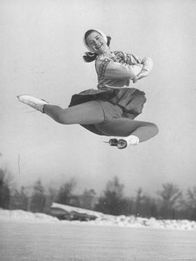 Barbara Ann Scott Smiling as She Leaps in Air on Skates at World Figure Skating Championship by Tony Linck