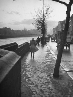 People Walking Through Dublin in the Rain by Tony Linck