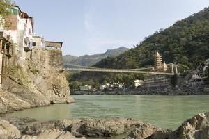 Ashrams on Banks of River Ganges, Lakshman Jhula, Rishikesh, India by Tony Waltham