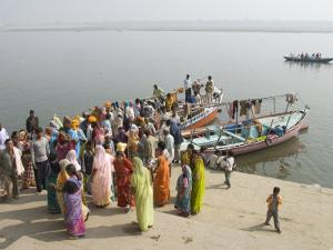 Boat on the River Ganges While a Cremation Takes Place, Varanasi, Uttar Pradesh State, India by Tony Waltham