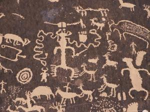 Indian Petroglyphs Drawn on Red Standstone by Scratching Away Dark Desert Varnish of Iron Oxides by Tony Waltham